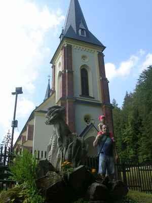 Kostel Povýšení sv. Kříže v Horní Lomné – Salajce  byl postaven nedaleko uctívaného dřevěného kříže, a to koncem 19. století v novogotickém slohu.